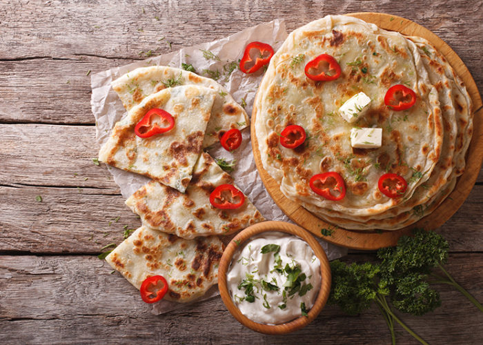 Indian paratha stuffed with potatoes on the table. horizontal view from above